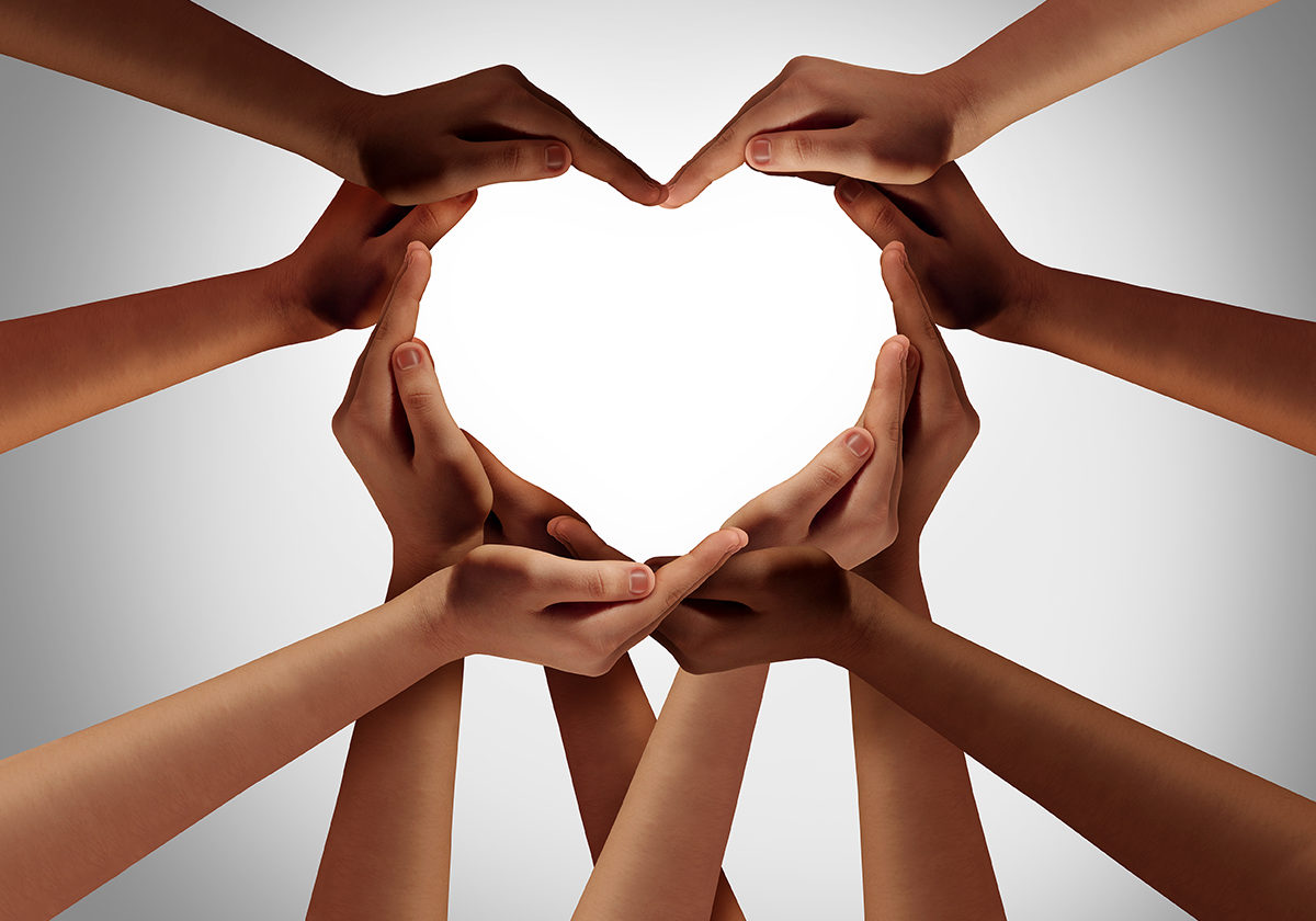 Heart hands as a group of diverse people hands connected together shaped as a love symbol expressing the feeling of being happy and togetherness.
